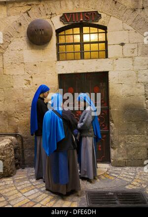 Nuns praying at the Seventh Stations on the Via Dolorosa, Via Dolorosa, Way of Sorrows, Stations of the Cross, Old - Stock Photo