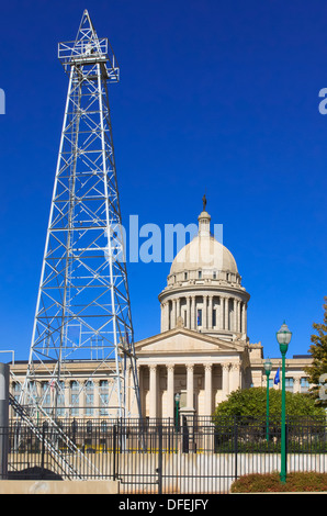 The Oklahoma State Capitol Building in Oklahoma City with an oil derrick in the foreground - Stock Photo