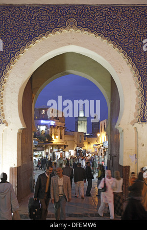 The blue gate Bab Bou Jeloud, entrance to the medina old town of Fes el Bali in the early evening, Fes, Morocco, - Stock Photo