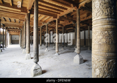 The wooden pillars inside the Juma Mosque in the Ichon - Qala (Old Town), Khiva, Uzbekistan, Central Asia - Stock Photo