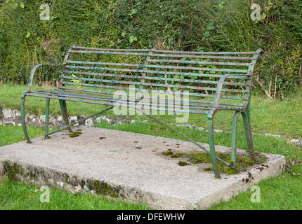 ornate old cast iron public bench seat - Stock Photo