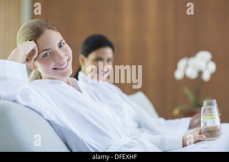 Women relaxing together in spa - Stock Photo