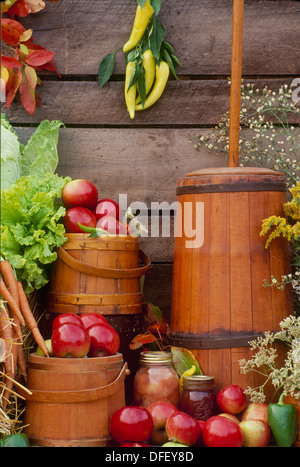Antique butter chrun and shaker boxes with apples and apple butter on display at farmers market, Vermont USA - Stock Photo
