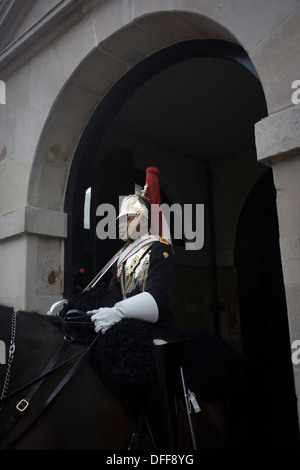 A black mounted lifeguard trooper parades at Horseguards in Whitehall, Westminster, Central London. This regiment - Stock Photo