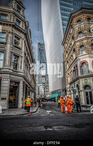 Construction workers at  Fenchurch Street London with the Walkie Talkie in the background - Stock Photo