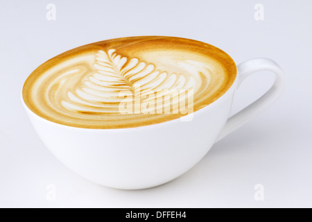 Cappuccino in a white cup on a white background - Stock Photo