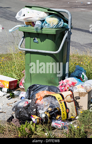 Rubbish overflowing from roadside bin at motorway services, Belgium - Stock Photo