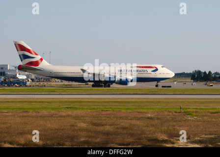 British Airways Boeing 747-436 taxiing down runway at YVR, Vancouver International Airport. - Stock Photo