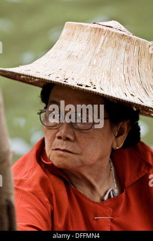Portrait of a Thai woman wearing a traditional hat. - Stock Photo