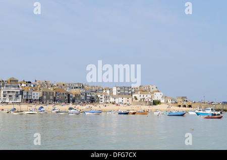 Fishing boats moored in cornish harbour on a sunny summer day - Stock Photo