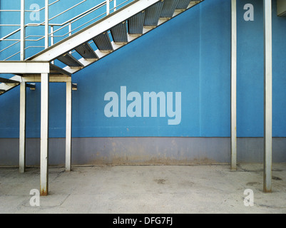 Wall background under metal staircase. - Stock Photo