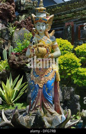 Indonesia, island of Bali, statue of the Goddess protective of the lake Batur at the Pura Ulun Danu Batur temple - Stock Photo
