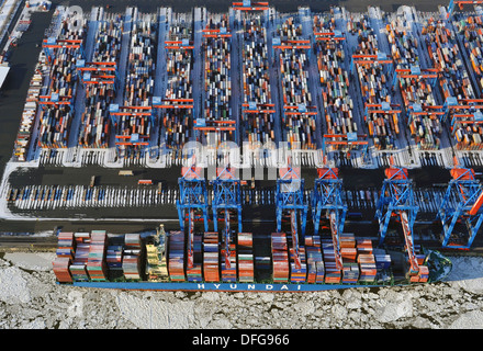 Container Terminal Altenwerder, container ship being loaded and unload, in winter, aerial view, Hamburg, Hamburg, - Stock Photo