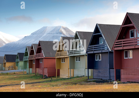Colourful houses in front of snow-capped mountains, Longyearbyen, Spitsbergen Island, Svalbard Archipelago - Stock Photo