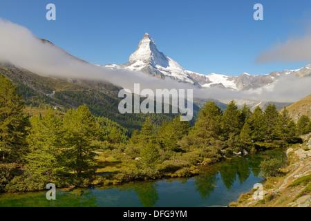 Larches (Larix) at Lake Grindjisee, in front of the Matterhorn, Valais Alps, Canton of Valais, Switzerland - Stock Photo