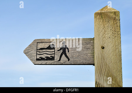 Finger signpost showing the route of the Wales Coast Path near Aberystwyth, Ceredigion, Wales, UK - Stock Photo