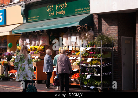 Customers Outside A greengrocers Fruit and Veg Shop Display UK - Stock Photo
