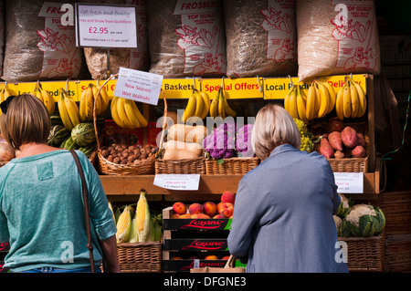 Women Browsing Outside A greengrocers Fruit and Veg Shop Display UK - Stock Photo