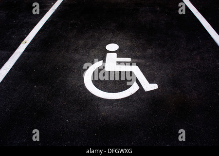disabled sign on parking space - Stock Photo