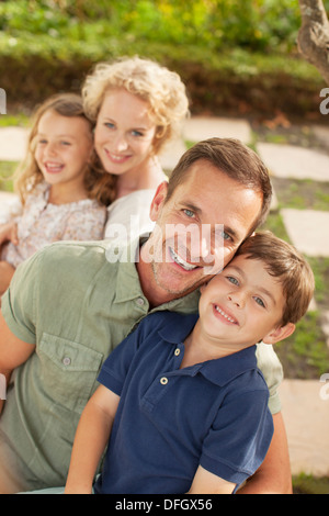 Portrait of smiling family outdoors - Stock Photo