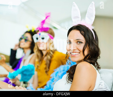 Woman wearing bunny ears at party - Stock Photo