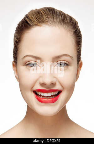 Smiling woman wearing red lipstick - Stock Photo