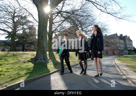 Two Girls and One Boy from a Public School walking in the Grounds of a UK leading Co Educational Independent School - Stock Photo