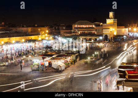 Hustle and bustle at night in Djemaa el Fna square, Marrakesh, Morocco - Stock Photo