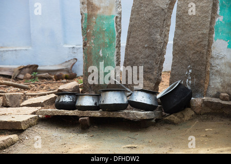 Indian kitchen cooking pots left to dry outside a rural indian village house. Andhra Pradesh, India - Stock Photo