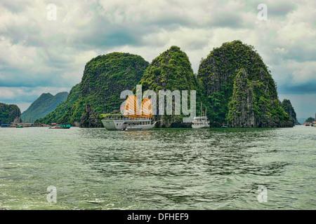 traditional junk sailing in Halong Bay, Vietnam - Stock Photo