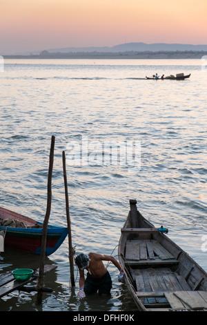 Bather at Ayeyarwady River, Mandalay, Myanmar, Asia - Stock Photo