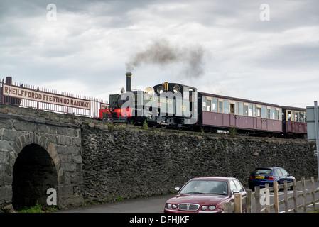 A train on the Ffestiniog Railway leaving from Porthmadog. - Stock Photo