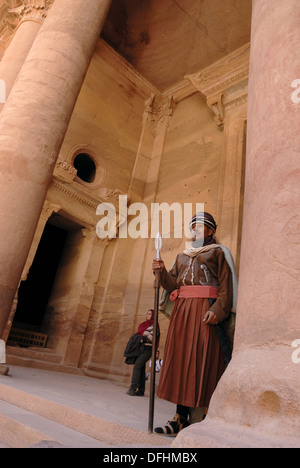 guard in costume of Al Khazneh or The Treasury, one of the most elaborate buildings of the ancient city of Petra, - Stock Photo