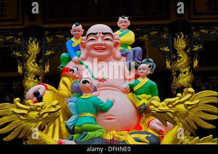 Pink Buddha at a village temple in Nha Trang, Vietnam - Stock Photo