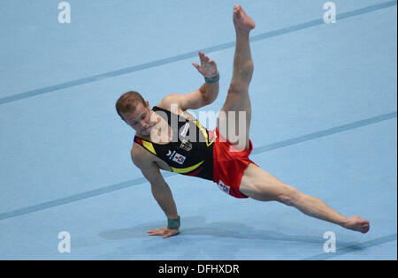Antwerp, Belgium. 05th Oct, 2013. Fabian Hambuechen of Germany competes on the Floor exercise during the Apparatus - Stock Photo