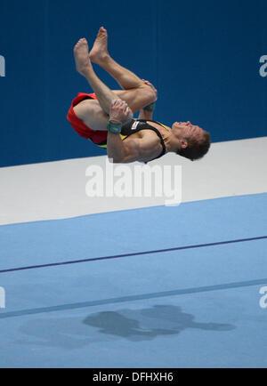 Antwerp, Belgium. 05th Oct, 2013. Fabian Hambuechen of Germany competes on the Floor during the men's Apparatus - Stock Photo