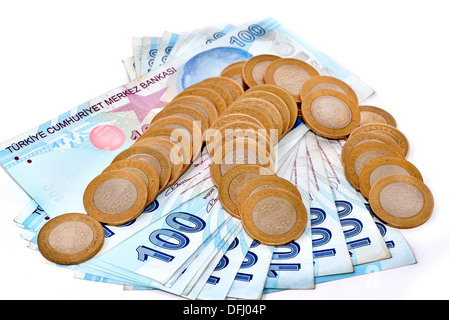 Turkish paper money and coins tower on white background - Stock Photo