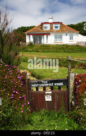 A bungalow with a notice saying 'The most southerly house' (in Britain). - Stock Photo
