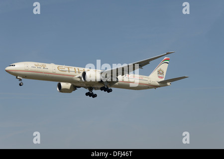 Etihad Airways Boeing 777-300 on final approach - Stock Photo