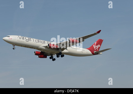 Virgin Atlantic Airways Airbus A340-300 on final approach - Stock Photo