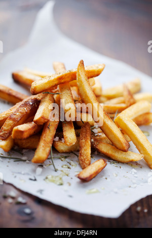 golden crispy french fries with salt and herbs - Stock Photo