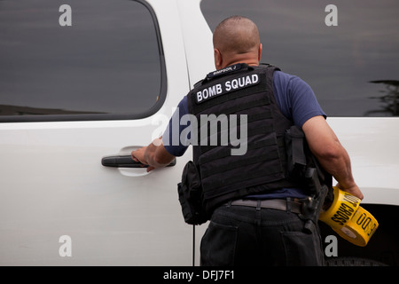 Bomb Squad technician with bullet proof vest - Stock Photo