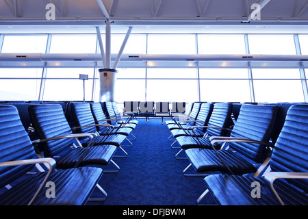 Empty seats at an airport terminal. - Stock Photo