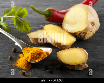 Fresh ginger root, red chili & ground turmeric. Indian spices - Stock Photo