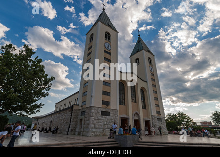 Unidentified men and women visit the Saint James church on June 13, 2009 in Medjugorje, Bosnia and Herzegovina - Stock Photo