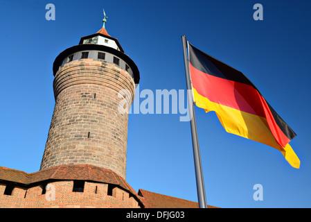 German flag flies at Nuremberg Castle in Nuremberg, Germany. - Stock Photo