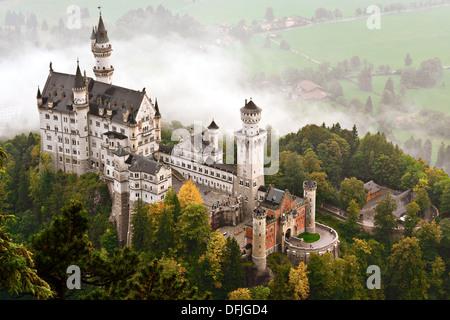Neuschwanstein Castle shrouded in mist in the Bavarian Alps of Germany. - Stock Photo