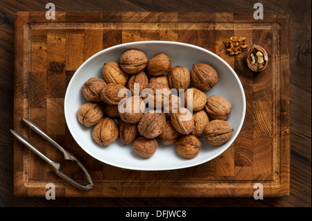 whole walnuts in a bowl - Stock Photo