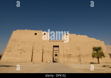 The Grand Pylons at the entrance to the Medinet Habu temple at Luxor Egypt. - Stock Photo