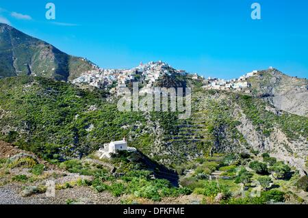 Woman preparing the fire, Olymbos Olympos, Karpathos island, Dodecanese, Greek Islands, Greece, Europe - Stock Photo